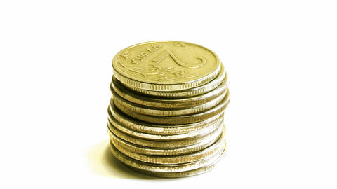 growing stack of coins isolated on white, then dec Footage