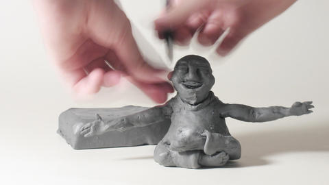 Timelapse Sculptor Modeling Plasticine Cartoon Fig stock footage