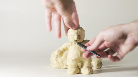timelapse sculptor modeling plasticine comic figur Stock Video Footage