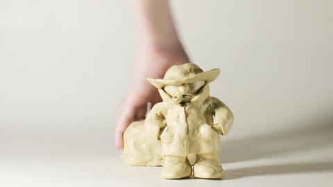 timelapse sculptor modeling plasticine comic figur Footage