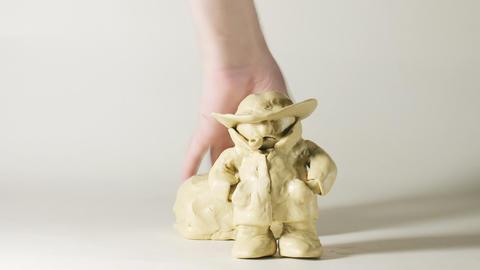 timelapse sculptor modeling plasticine comic figur Stock Video Footage