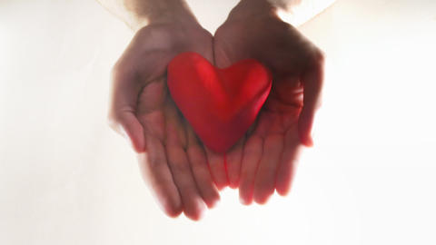 Clay Modeling Red Heart In Hands stock footage