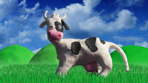 clay animation cow eating grass Stock Video Footage