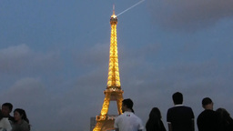 Visitors enjoying the lights and laser beam of Eiffel... Stock Video Footage