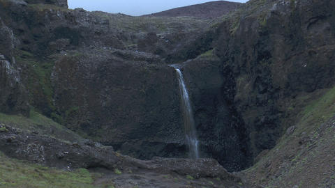 Waterfall At Volcanic Crater In Iceland stock footage