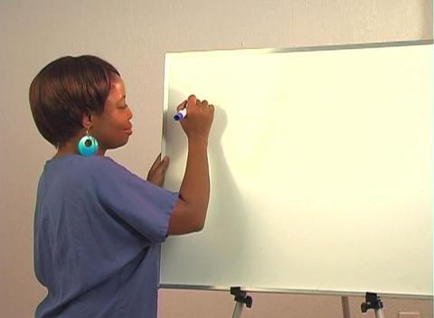 "Beautiful Nurse Writes ""Coronary Artery Bypass"" on a... Stock Video Footage"