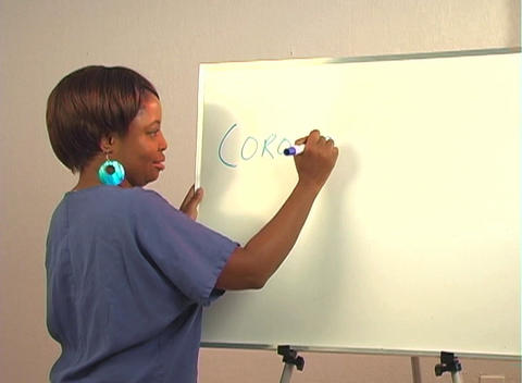 "Beautiful Nurse Writes ""Coronary Artery Bypass"" on a... Stock Video Footage"