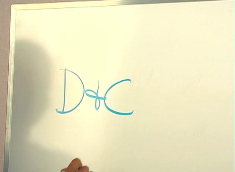 "Beautiful Nurse Writes ""D&C"" on a White Board (close-up) Footage"