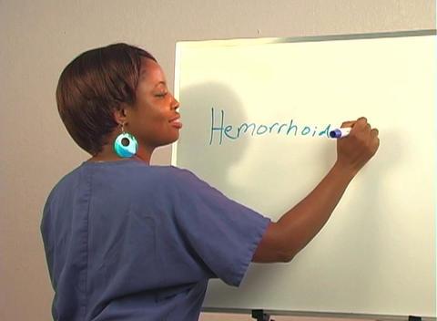 "Beautiful Nurse Writes ""Hemorrhoidectomy"" on a White Board Footage"