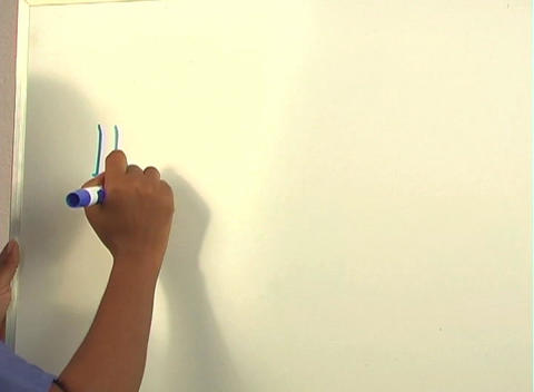"""Beautiful Nurse Writes """"Hysterectomy"""" on a White Board... Stock Video Footage"""