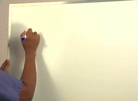 "Beautiful Nurse Writes ""Hysteroscopy"" on a White Board... Stock Video Footage"