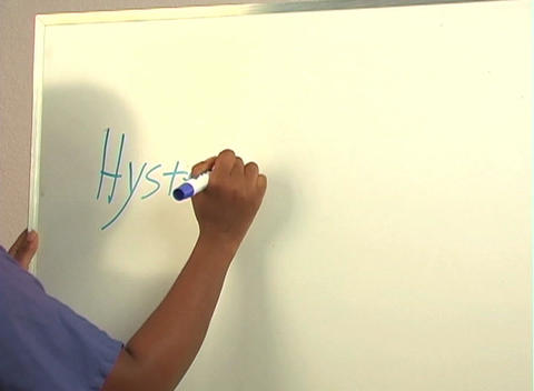 "Beautiful Nurse Writes ""Hysteroscopy"" on a White Board... Stock Video Footage"