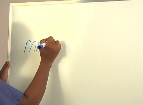 "Beautiful Nurse Writes ""Mastectomy"" on a White Board... Stock Video Footage"