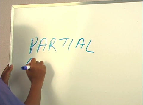 """Beautiful Nurse Writes """"Partial Colectomy"""" on a White... Stock Video Footage"""