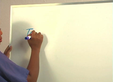 """Beautiful Nurse Writes """"Tonsillectomy"""" on a White Board... Stock Video Footage"""