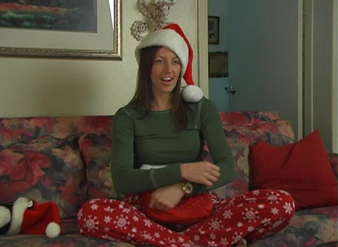Beautiful Brunette Pulls a Suprise From Her Christmas Bag Stock Video Footage