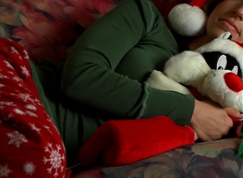 Beautiful Brunette Takes a Christmas Nap Stock Video Footage