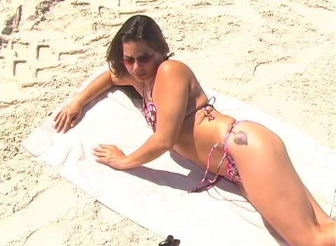 Bikini-clad Brunette on the Beach-1b Stock Video Footage