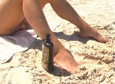 Bikini-clad Brunette on the Beach-2a Stock Video Footage