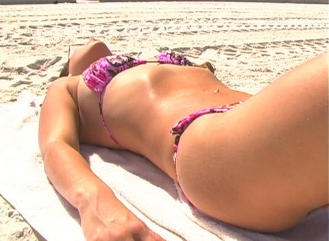 Bikini-clad Brunette on the Beach-2a Stock Video Footage