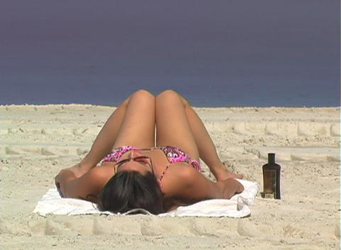 Bikini-clad Brunette on the Beach-4 Stock Video Footage