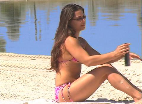 Bikini-clad Brunette on the Beach-13 Stock Video Footage
