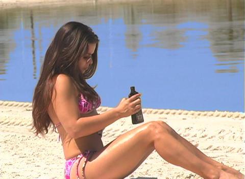 Bikini-clad Brunette on the Beach-15 Stock Video Footage