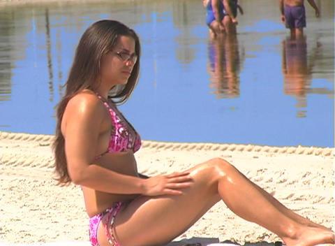 Bikini-clad Brunette on the Beach-17 Stock Video Footage