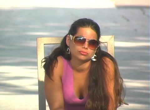 Beautiful Brunette Sitting in a Street-1 Stock Video Footage