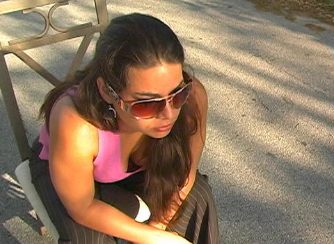 Beautiful Brunette Sitting in a Street-5 Stock Video Footage
