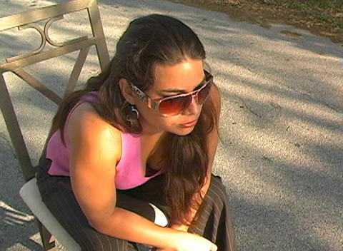 Beautiful Brunette Sitting in a Street-5 Footage