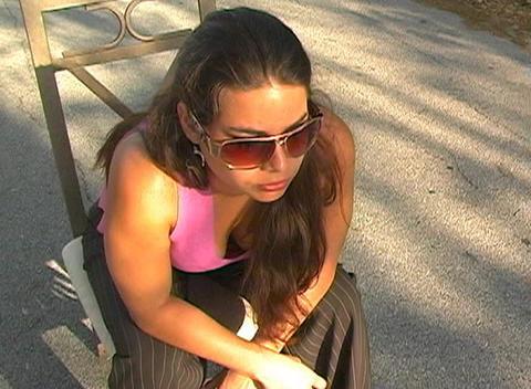 Beautiful Brunette Sitting in a Street-5 Stock Video Footage
