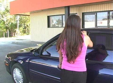 Beautiful Brunette Enters Her Car-1 Stock Video Footage