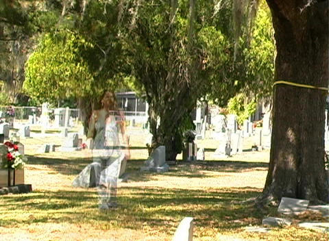Female Ghost in a Cemetery (1) Stock Video Footage