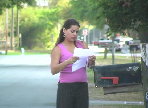 Hot Brunette Gets her Mail-1b Stock Video Footage