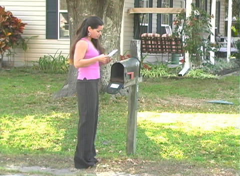 Hot Brunette Gets her Mail-2a Stock Video Footage