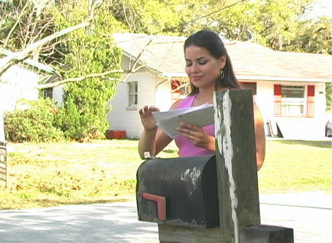 Hot Brunette Gets her Mail (sequence) Stock Video Footage