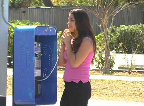 Beautiful Brunette on a Pay Phone-1a Stock Video Footage