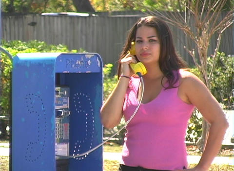 Beautiful Brunette on a Pay Phone--2 Stock Video Footage