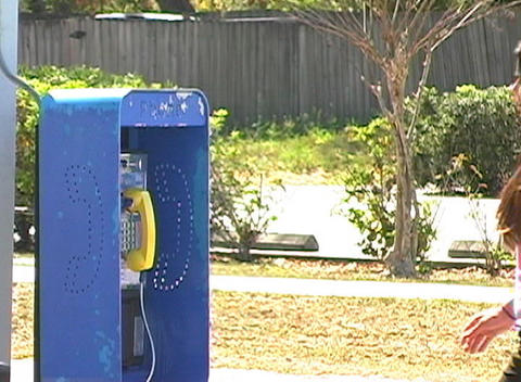 Beautiful Brunette Talks on a Pay Phone (sequence) Stock Video Footage