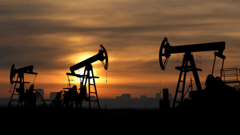working oil pumps silhouette against sunrise Footage