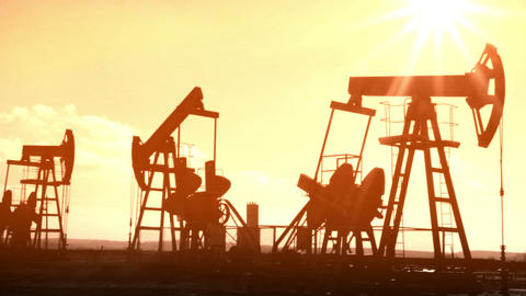 oil pumps silhouette - old movie styled timelapse Stock Video Footage