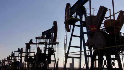 many working oil pumps silhouette Stock Video Footage