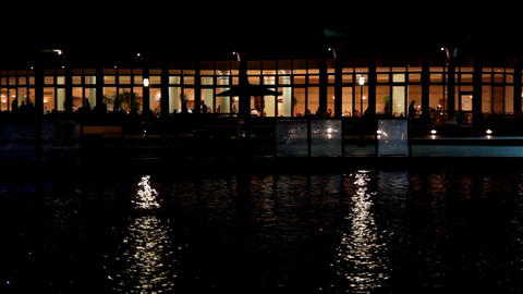 Night view of the restaurant by the pond Stock Video Footage