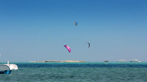 kite surfing - surfers on blue sea surface - timel Stock Video Footage