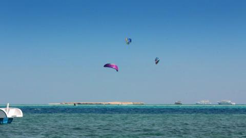 kite surfing - surfers on blue sea surface - timel Footage