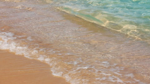 turquoise sea water waves and sand beach - slow mo Footage
