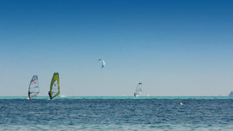 surfing - windsurfers and kitesurfer on blue sea s Footage