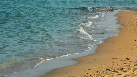 turquoise sea water waves and sand beach - timelap Footage