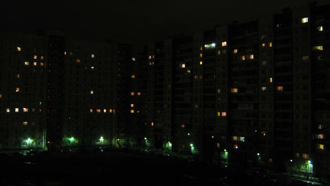windows in houses are lit at night and go out - ti Stock Video Footage